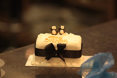 Finishing Touches (brandy_shot) Tags: black art cake shop penguins dof hand market bokeh line story covered bow oxford ribbon playful sooc