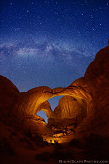 "Double Arch and Milky Way stars (IronRodArt - Royce Bair (""Star Shooter"")) Tags: park light sky lightpainting southwest monument nature rock night dark painting way stars evening utah twilight sandstone shiny long exposure heaven glow arch shine nightscape time dusk infinity space deep arches twinkle landmark double astro sparkle galaxy national astrophotography astronomy archesnationalpark universe exploration milky cosmic starry cosmos constellation distant milkyway starlight doublearch wondersofnature starrynightsky"