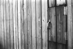 Tor 2 (chipsmitmayo) Tags: wood blackandwhite bw nova wall 50mm minolta f14 wand 400 agfa schwarzweiss holz alto xd7 apx tr sdtirol adige dolomiten levante rokkor welschnofen