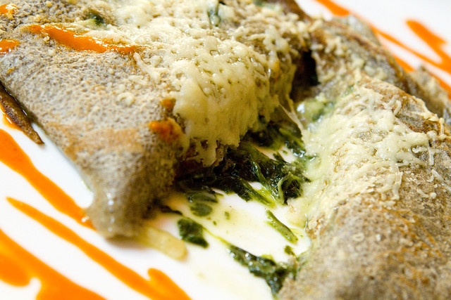 buckwheat crepe with spinach, pine nuts, and raisins