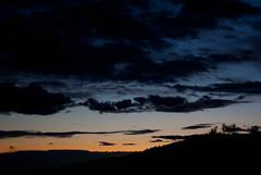 Dias que acaban. (PhotoSage) Tags: street blue sunset espaa orange mountain silhouette azul clouds canon atardecer eos 50mm spain arboles carretera nubes silueta vistas montaa naranja tress tarragona 1000d