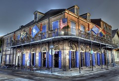 Bourbon Pub (Ken Yuel) Tags: bike bicycle unitedstates neworleans flags frenchquarter lousiana shutters waterhose blueshutters digitalagent kenyuel sidewalkwashing bourbonpubandparade