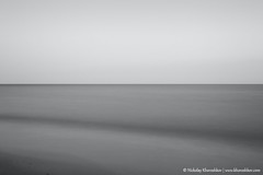 Monochrome photo of seascape (nickolay_khoroshkov) Tags: ocean old sea sky white seascape abstract black beach nature monochrome vintage landscape bay coast sand long exposure background shell calm retro coastal coastline hoizon