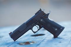 STI Edge (Timo Vehviläinen) Tags: gun dof bokeh edge pistol shooting handgun sti firearm 2011 canonef135mmf2l