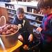 Volunteers Sasha Wilkerson and Jim Clark Stewart peel potatoes at First Church Shelter.