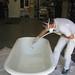 clawfoot tub during restoration