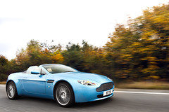 Shmee at Speed. (Alex Penfold) Tags: auto camera blue cars alex sports car sport mobile speed canon photography eos photo moving cool flickr shot martin image awesome flash picture fast convertible super spot 150 exotic photograph a3 spotted hyper panning supercar v8 tracking aston spotting tb astonmartin 87 exotica sportscar vantage sportscars supercars roadster penfold shmee spotter 2011 hypercar 60d hypercars v8v alexpenfold shmee150 87tb