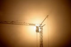 crane silhouette (diwan) Tags: city brown sun silhouette fog canon germany geotagged deutschland eos nebel place crane magdeburg stadt braun sonne morgens inthemorning 2011 baukran saxonyanhalt sachsenanhalt canoneos450d geo:lon=11647984 geo:lat=52132824