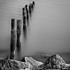 Gwynne's Point, Va. II (qixtepr) Tags: longexposure bw water rock square landscape sep pilings sfx 500x500 utatafeature nd110 vaii vanagram silverefexpro2 gwynnespoint 5x5bw90