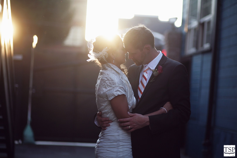 Bride and Groom Hugging in Sodo Park Sunset