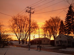 Bright Sunset Over Freshly Fallen Snow. (dccradio) Tags: autumn trees winter sunset house snow building tree fall colors pinetree wisconsin mailbox evening dusk flag flags pole powerlines evergreen firstsnow utilitypole powerpole wi electricpole barricade newspaperbox electriclines marshfield centralwisconsin constructionbarricade