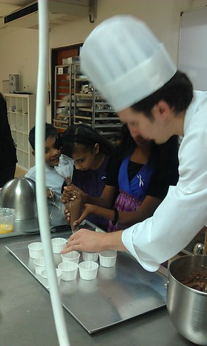 The nice chef (forgot his name) showing the kids how cupcakes are made