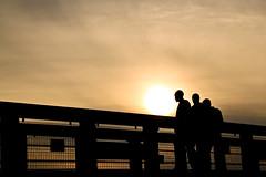 Over the Bridge, Cardiff (Down by the River, Orange Glow) (geezaweezer) Tags: street bridge people orange sun yellow wales glow shadows cardiff silhouettes taff susnet bute cardydd travelpark geezaweezer