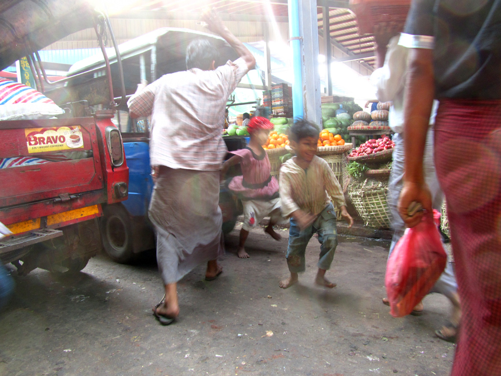 Kids Escaping a Spanking at a Burmese Market