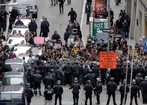 New York cops barricade streets to prevent demonstrators from reaching Wall Street on November 17, 2011. The city shutdown Zuccotti Park on November 15 to halt the anti-capitalist encampment. by Pan-African News Wire File Photos