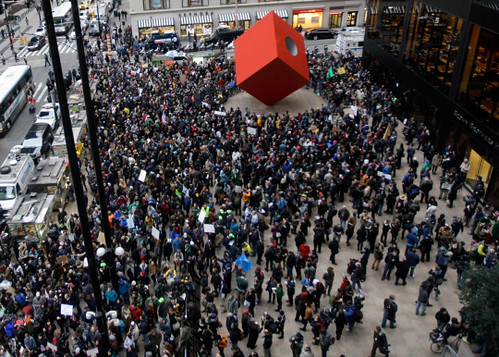 Crowds gather in the Wall Street district in New York to protest the austerity measures imposed by the capitalist system. Arrests were reported as police moved to protect the financial institutions. by Pan-African News Wire File Photos
