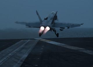 An F/A-18C Hornet launches from USS John C. Stennis (CVN 74).