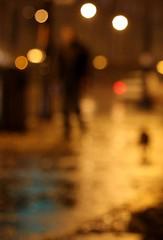 Man Walks Alone? (Philocycler) Tags: chicago reflection rain bokeh dream vision michiganavenue dreamorreality canon50mm14 canonrebelt2i manwalksalone