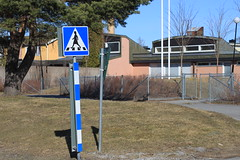 female crossing sign (frettir) Tags: school woman crossing sweden zebra ralph erskine gyttorp vergngsstlle frugrman