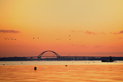 Sunrise at Fehmarn Sound Bridge (dubdream) Tags: ocean bridge sunset sea sky orange sun colour water germany see nikon meer wasser balticsea fehmarn fehmarnsundbrcke d700 dubdream