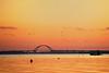 Sunrise at Fehmarn Sound Bridge (dubdream) Tags: ocean bridge sunset sea sky orange sun colour water germany see nikon meer wasser day balticsea clear fehmarn fehmarnsundbrücke d700 dubdream