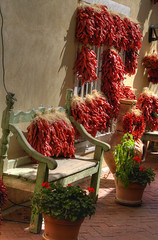 Bench and chile peppers (JoelDeluxe) Tags: chile red newmexico alley albuquerque nm joeldeluxe oldtown hdr ristra