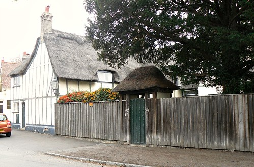 Thatched cottage and gateway