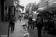late afternoon (Paul Steptoe Riley) Tags: street uk england people urban blackandwhite woman streets male london english public girl female photography britain candid soho streetphotography documentary pedestrians british westend motherandchild berwickstreet stalls londonstreet blackandwhiteurban