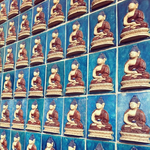 Glazed #Budha tiles on the wall of the White #Pagoda at #BeihaiPark in #Beijing #China. #obievip  #obievip_china by ObieVIP