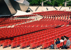 Red Chairs (JJide) Tags: park red chicago 35mm frank jay chairs rehearsal watching millenium gehry seats pavilion pritzker d7000