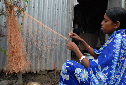 Woman weaving a fishing net, Bangladesh. Photo by WorldFish, 2007