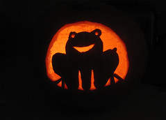 silhouette of a smiling frog, jack-o-lantern style