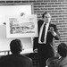 LeRoy Troyer, showing a conceptual sketch of what became the current seminary building, has been the lead architect for EMU for 30 years.