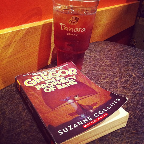 Project 365 278/365: My current status: Panera, a large drink, and children's fiction from Suzanne Collins.