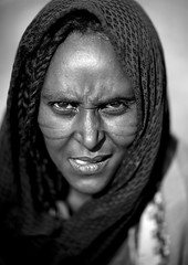 Miss Gale, Karrayyu tribe - Ethiopia (Eric Lafforgue) Tags: africa people blackandwhite woman face look vertical tattoo female outside outdoors person veil noiretblanc portait femme hijab tribal headshot cheeks ethiopia tribe scar cicatrice voile personne humanbeing scars scarification tete visage regard contemplation afrique tribu tatouage dehors eastafrica abyssinia ethiopie exterieur lookingatcamera traditionalclothes scarifications blackandwhitepicture 5752 abyssinie vueexterieure joues afriquedelest islamicveil etrehumain voileislamique photoennoiretblanc regardantlobjectif karayu karrayyu tribudeskarrayyus karrayyutribe peuplekarrayyu karrayyupeople habittraditionnels villedemethara metharatown methara