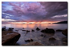 Unpredictable (Dolly MJ) Tags: sunset sky beach water clouds moving waves borneo slowshutter kotakinabalu sabah rockybeach southchinasea longexpose ombak beautifulsunset borneoisland northborneo kksunset