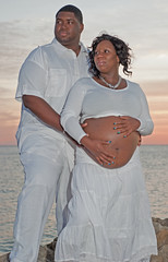 Family... (Rock.Solid.One) Tags: family blue sunset portrait orange sunlight black love beach water beauty clouds 50mm bay necklace eyes nikon couple purple wind bell tampabay teeth horizon flash watch sb600 smiles maternity bayarea africanamerican fl clearwaterbeach nikkor fla speedlight clearwater 50mm18 centralflorida braclet