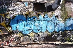 Amsterdam Graffiti (Michaelasixfive) Tags: street light shadow art amsterdam bicycle illustration graffiti beans alley arty view pavement pipe s gritty tenfoot