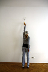 Wall Painting (C_MC_FL) Tags: woman white wall painting person photography diy fotografie flat sold wand jeans behind frau wohnung rcken gettyimages weis ausmalen zeitungshut gettysalq4