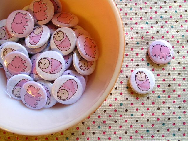 Baby girl buttons and baby elephant buttons.
