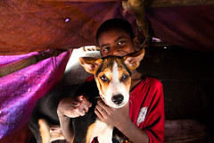 Similar Fates - II (Catch the dream) Tags: street friends boy dog smile accident disabled dhaka streetchildren bangladesh streetdog childworker