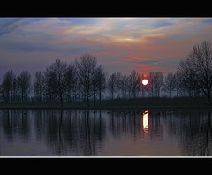 Jewel in the crown (Wim Koopman) Tags: blue sunset red sky orange sun lake holland color colour reflection water netherlands dutch landscape photography golden evening geese photo duck pond sundown magic stock nederland hour stockphoto stockphotography goudriaan wpk slingeland
