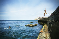 hands up I surrender!! (blackeyeliner) Tags: sea playing gulfofmexico kids swimming children jumping rocks waterfront havana cuba diving northamerica canoneos5d primelens centrohabana elmalecon greaterantilles canonef24mmf28 floridastraits antillesislands