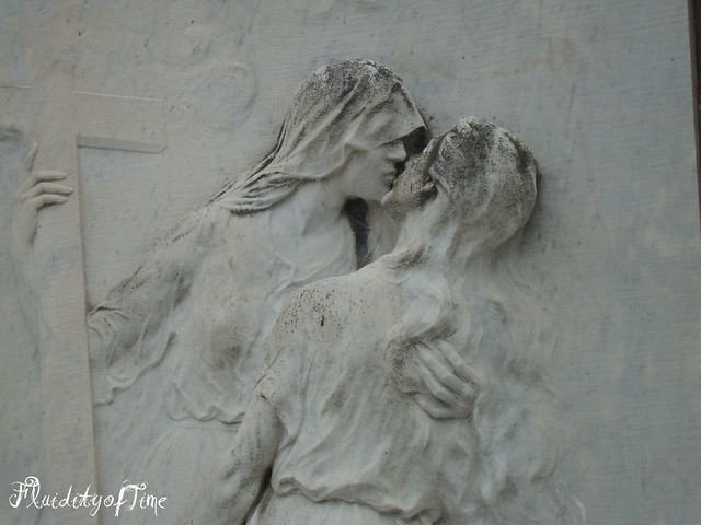 Venice, San Martino cemetery marble detail of kiss