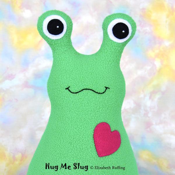 Fleece Hug Me Slug, Kelly green with red heart, by Elizabeth Ruffing