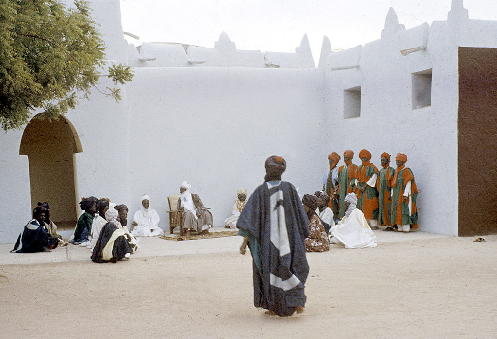 The Emir of Katsina, Sir Alhaji Usman Nagogo, holding a morning greeting ceremony, Katsina, Nigeria. [slide] 1959. eepa_01368