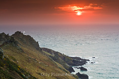 Start Point Sunrise (Olly Plumstead) Tags: ocean red sea orange lighthouse seascape green water grass start sunrise canon point landscape 50mm coast rocks cloudy coastal devon land coastline olly f18 plumstead 450d