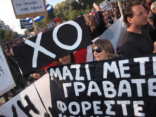 Greek protesters close down military parade during anti - government protest