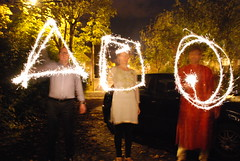 Diwali sparklers, John draws a triangle, Antonia draws a square and Kesavan draws a circle (adambangor) Tags: party england festival fireworks lakshmi sparklers lighttrails diwali festivaloflights newcastleupontyne tynewear tyneandwear fenham goddessofwealth