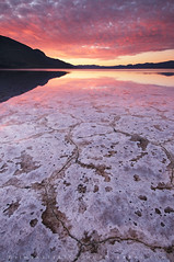 Morning Yearning - Badwater, Death Valley, California (Jim Patterson Photography) Tags: california morning travel winter usa lake mountains nature water vertical clouds sunrise reflections landscape colorful patterns salt scenic basin valley badwater saltpan furnacecreek deathvalleynationalpark inyocounty lakemanley jimpattersonphotography jimpattersonphotographycom seatosummitworkshops seatosummitworkshopscom